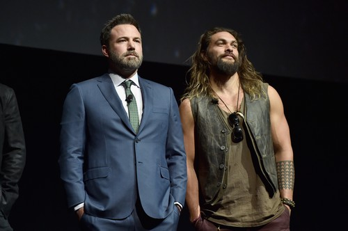 "LAS VEGAS, NV - MARCH 29:  Actors Ben Affleck (L) and Jason Momoa speak onstage at CinemaCon 2017 Warner Bros. Pictures Invites You to ""The Big Picture"", an Exclusive Presentation of our Upcoming Slate at The Colosseum at Caesars Palace during CinemaCon, the official convention of the National Association of Theatre Owners, on March 29, 2017 in Las Vegas, Nevada.  (Photo by Alberto E. Rodriguez/Getty Images for CinemaCon)"