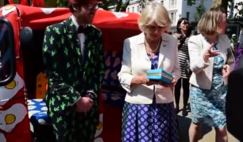 Camilla Parker-Bowles Shocks World With Horrendous 'Baked Beans' Purse At Event Celebrating Late Brother (VIDEO)