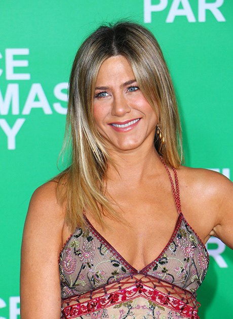 Jennifer Aniston Fuels Pregnancy Reports, Rubs Alleged Baby Bump During 'Christmas Party' Red Carpet Event