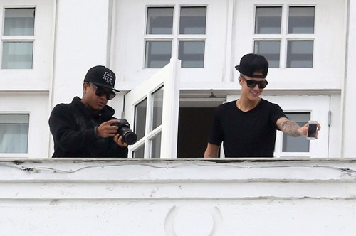 Justin Bieber's Brazilian Whorehouse Visit: Happy Customer Sneaks Out With Two Prostitutes