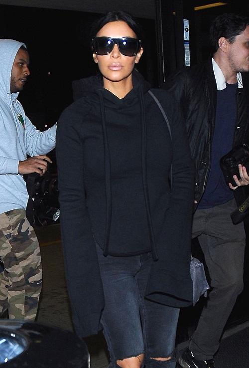 Kim Kardashian & Kanye West Departing On A Flight At LAX