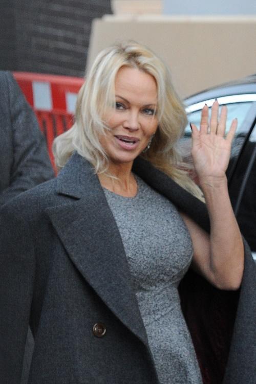 Pamela Anderson Slams Queen Elizabeth Over Black Bear Fur Hat Controversy