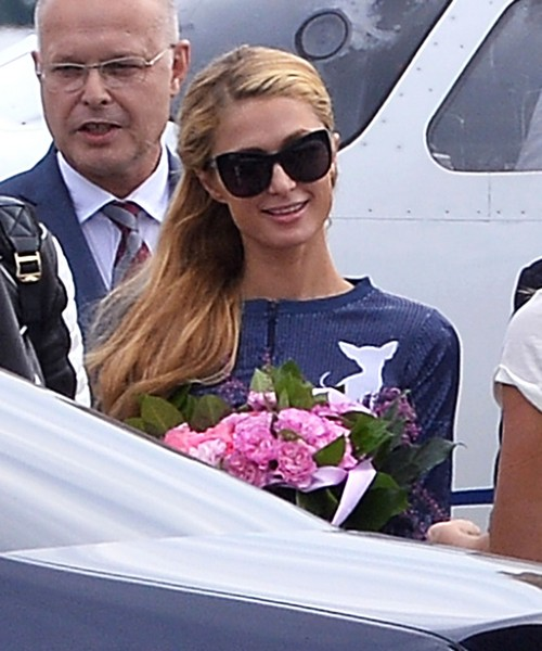 Paris Hilton Arrives in Poland for Polish Fashion Week Looking Gorgeous - DJ'ing Gig to Showcase Amazing Skills (PHOTOS)