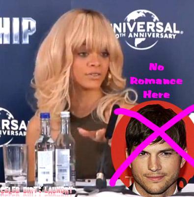 A Feisty Rihanna Shoots Down British Reporter: 'I'm Single,' Not Dating Ashton Kutcher (Video)